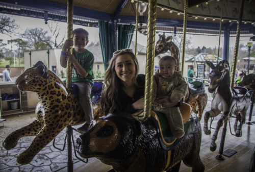 Cash, Kayla and Cale riding he Merry Go Round Carousel at the St. Louis Zoo